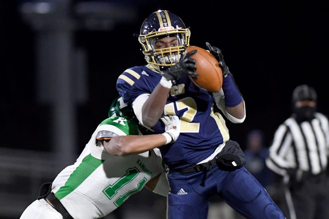Roberson's Rodney Mcday catches a pass against A.L. Brown's Dezmond Adams during their first-round playoff game at Roberson High School on Nov. 15, 2019. Roberson was defeated 56-50 and will not advance.