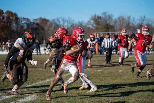 Colon senior Phillip Alva (11) rushes the ball during the 8-player Division 1 state semifinal on Saturday, Nov. 16, 2019 at Colon High School in Colon, Mich.