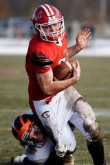 Morrice junior Garret Delau (18) tackles Colon junior Brandon Crawford (20) during the 8-player Division 1 state semifinal on Saturday, Nov. 16, 2019 at Colon High School in Colon, Mich.
