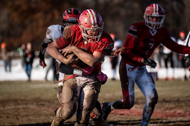 Colon junior Brandon Crawford (20) rushes the ball during the 8-player Division 1 state semifinal on Saturday, Nov. 16, 2019 at Colon High School in Colon, Mich.