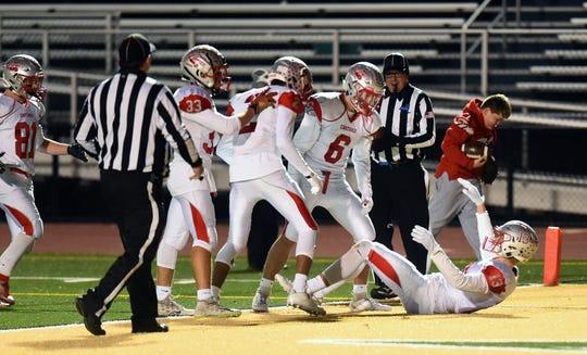 Carthage celebrates a third quarter touchdown during the third quarter of Carthage vs. Union-Endicott, Class A regional football, Vestal High School, Friday, November 15, 2019.