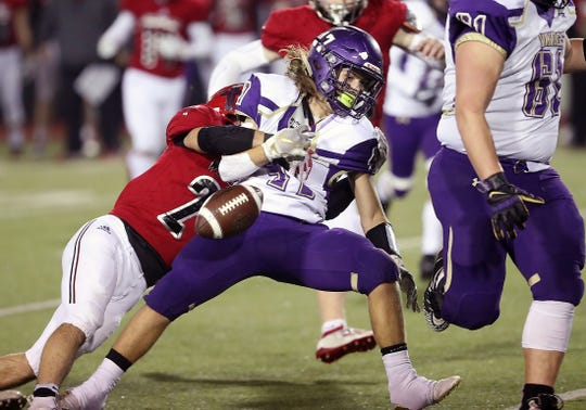 Archbishop Murphy's  Joe Ennis strips the ball out North Kitsap's Josh Fisher's grasp with a tackle on Friday, November 15, 2019 at Everett Memorial Stadium. Archbishop Murphy gained possession of the ball on the play.