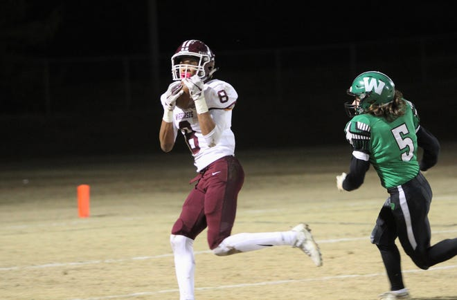 Fred Graves hauls in one of his two touchdown receptions against West Stanly on Nov. 15.