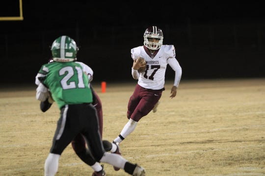 Owen junior Dequan Boyce carries the ball against West Stanly on Nov. 15, as the Warhorses advanced to the second round of the playoffs with a 27-7 win. Boyce rushed for 111 yards in the contest.