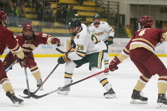 Vermont's William Lemay (28) skates with the puck during the men's hockey game between the Boston College Eagles and the Vermont Catamounts at Gutterson Field House on Friday night November 15, 2019 in Burlington, Vermont.