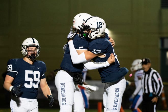 Shawnee's Matt Welsey (5) and Nate Summerville (12) celebrate a touchdown against Millville in the South Jersey Group 4 semifinals Friday. Nov. 15, 2019 in Medford, N.J. Shawnee won 27-18.