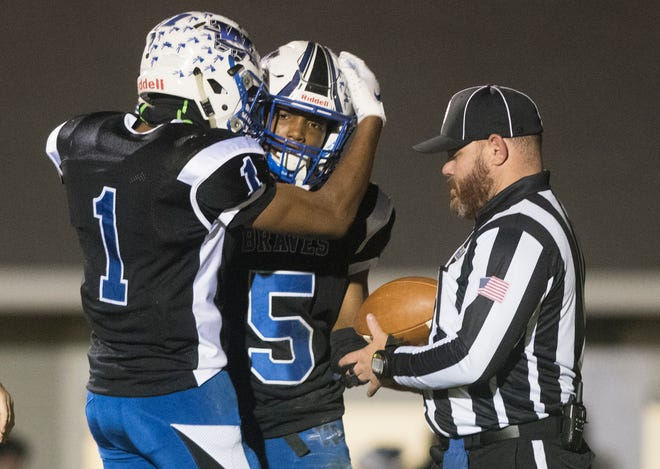 Williamstown's Turner Inge is congratulated by Williamstown's Mekhi Gamble, left, after Inge scored a touchdown during the 4th quarter of the South Jersey Group 5 football semi-final game between Williamstown and Vineland, played at Williamstown High School on Friday, November 15, 2019.  Williamstown defeated Vineland, 34-14.