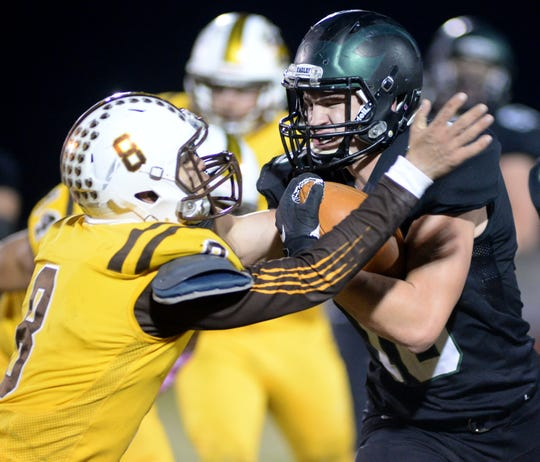 West Deptford's Cody Thurston breaks a tackle by Delran's Eren Ibas as he carries the ball during Friday night's South Jersey Group 2 semifinal football game at West Deptford High School, Nov. 15, 2019.