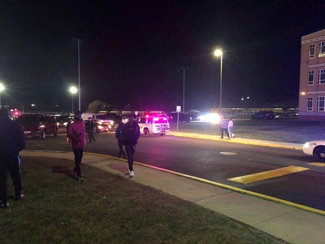 Game attendees leave after shots rang out Friday at a Pleasantville-Camden high school football playoff game in Pleasantville.