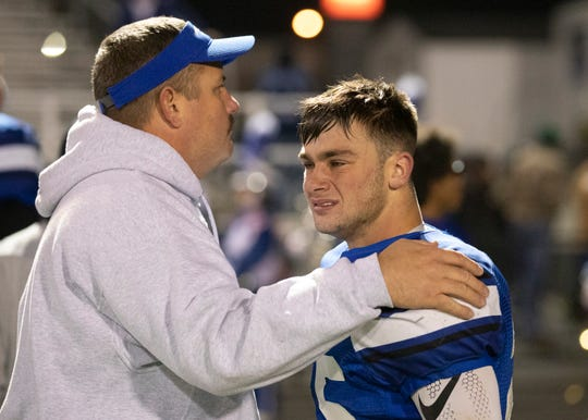 Coach Evan Gallaugher has a moment with senior quarterback Lane Ruby after falling to Covington 36-20 in a Division VI regional semifinals game in Xenia, Ohio, on November 15, 2019.