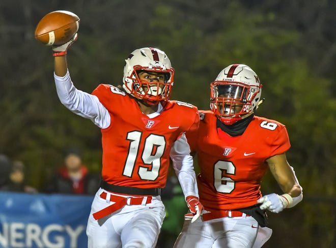 Jaydan Mayes (19) and Antaun Hill (6) of Fairfield celebrate after an interception against Colerain during the OHSAA regional playoff Friday, Nov. 15, 2019.