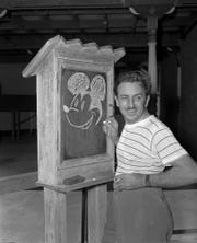 "Walt Disney, creator of Mickey Mouse, poses at the Pancoast Hotel in Miami, Fla., on Aug. 13, 1941.  An animation innovator, Disney featured  his favorite character in ""Steamboat Willie,"" the first short cartoon with a soundtrack, in September 1928.  He released his first full-length animated film, ""Snow White and the Seven Dwarfs,"" in 1937.   A multimedia visionary whose name became synonymous with family entertainment, Disney  expanded into television and book publishing, and led the way for a new kind of amusement park known as the ""theme park.""  Disney opened Disneyland in California in the 1950s."