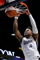 Xavier Musketeers forward Tyrique Jones (4) throws down a dunk in the first half of the NCAA basketball game between the Xavier Musketeers and the Missouri State Bears at the Cintas Center in Cincinnati on Friday, Nov. 15, 2019.