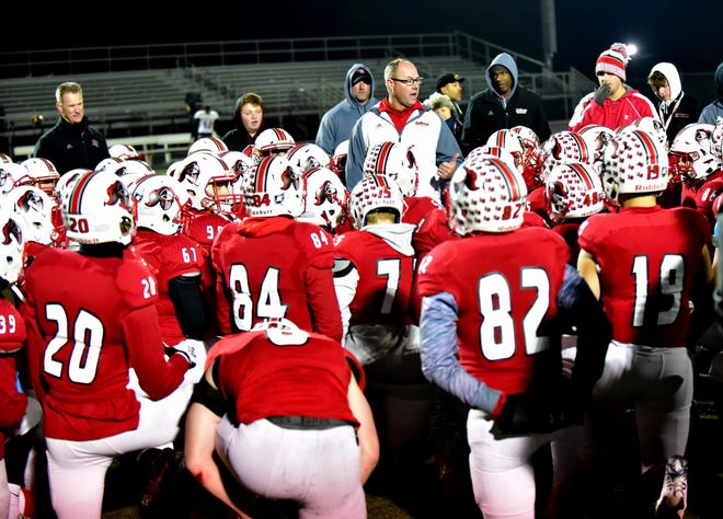 It's on to the OHSAA Division II regional finals against Harrison as the post-game coaches huddle was brief for the La Salle Lancers, who celebrated their 35-7 win in the Division II regional semifinal against Columbus-Walnut Ridge, Nov. 15, 2019.