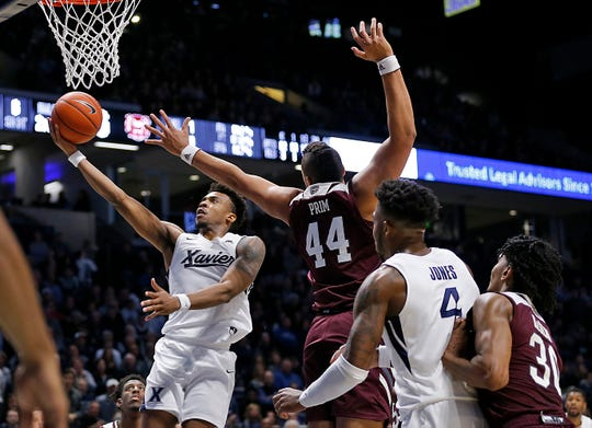 Xavier Musketeers guard Paul Scruggs (1) puts in the game-winning layup in the final seconds of the second half of the NCAA basketball game between the Xavier Musketeers and the Missouri State Bears at the Cintas Center in Cincinnati on Friday, Nov. 15, 2019. Xavier remained undefeated with a 59-56 win.