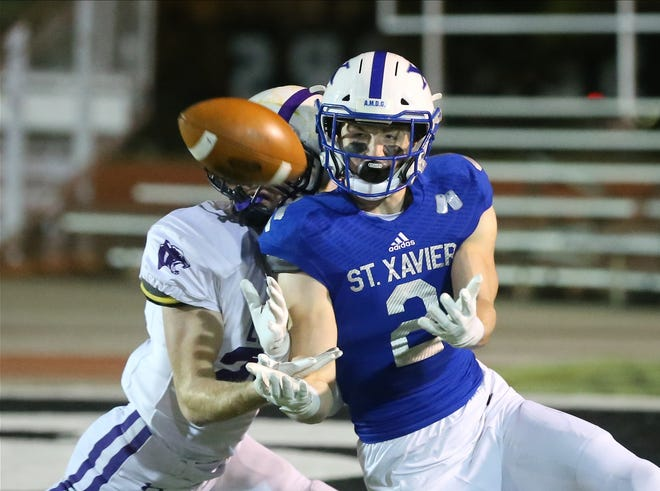 St. Xavier wide receiver Liam Clifford (2) catches a pass during the Bombers' 28-24 loss to Elder, Friday, Nov. 15, 2019.