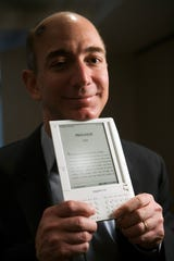 Jeff Bezos, founder and CEO of Amazon.com, introduces the Kindle at a news conference on Monday, Nov. 19, 2007 in New York. The $399 electronic book device will allow downloads of more than 90,000 book titles, blogs, magazines and newspapers.