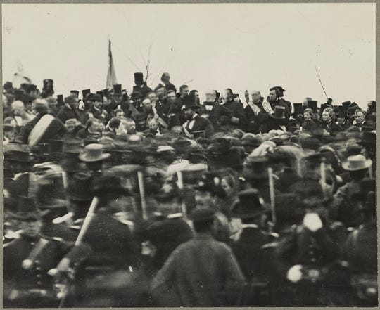 One of the two confirmed photos of President Abraham Lincoln (center, facing camera) at Gettysburg, taken about noon, just after he arrived and some three hours before his speech.