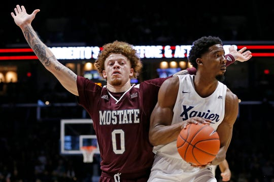 Xavier Musketeers guard Quentin Goodin (3) drives against Missouri State Bears guard Tyrik Dixon (0) in the first half of the NCAA basketball game between the Xavier Musketeers and the Missouri State Bears at the Cintas Center in Cincinnati on Friday, Nov. 15, 2019.
