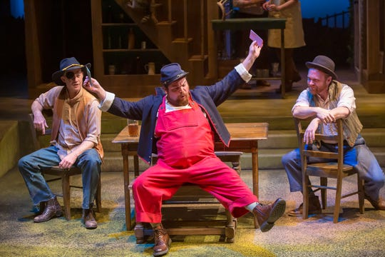 """Billy Chace (center) plays Sir John Falstaff in the Cincinnati Shakespeare Company's production of """"The Merry Wives of Windsor,"""" running through Dec. 7, 2019. He's a notorious Shakespeare scoundrel who, in this play, is attempting to woo two married women. With him are a pair of sidekicks, played by Justin McCombs (left) and Josh Katawick."""