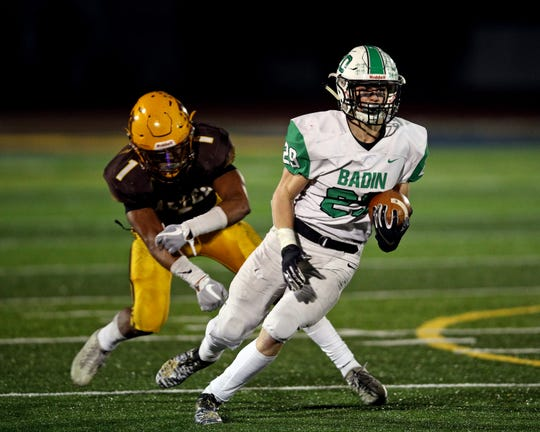 Badin running back Alex DeLong runs the ball for a first down in the OHSAA playoff game with Alter Nov. 15, 2019.