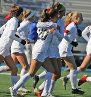 Corinna Zullo and Emily Mason of Hunterdon Central celebrate their teamÕs second goal of the game scored by Zullo in the first half during their win over Scotch Plains in the Group 4 Championship at Kean University on November 16, 2019.