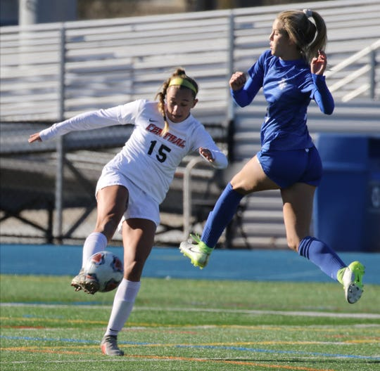 Emily Mason of Hunterdon Central kicks the ball as Leah Klurman of Scotch Plains tries to block it in the second half during their win over Scotch Plains in the Group 4 Championship at Kean University on November 16, 2019.