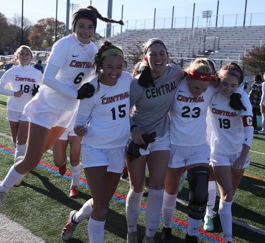 Maddy Bellew, Emily Mason, Lindsay Dewar, Lexi Sipos and Ciara Adams of Hunterdon Central celebrate their teamÕs win over Scotch Plains in the Group 4 Championship at Kean University on November 16, 2019.