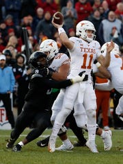 Linebacker Will McDonald #9 of the Iowa State Cyclones puts pressure on quarterback Sam Ehlinger #11 of the Texas Longhorns as offensive lineman Samuel Cosmi #52 of the Texas Longhorns blocks in the first half of play at Jack Trice Stadium on November 16, 2019 in Ames, Iowa.