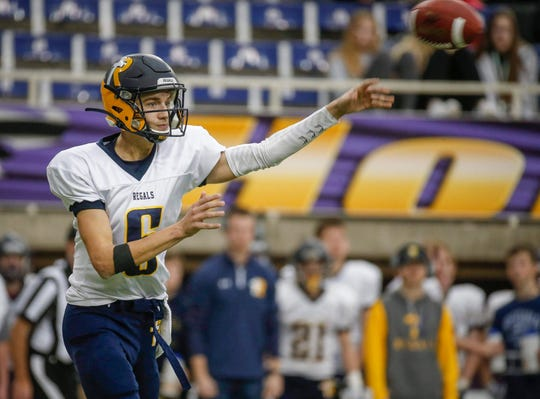 Iowa City Regina Catholic junior quarterback Ashton Cook fires a pass against Van Meter at the UNI-Dome in Cedar Falls on Saturday, Nov. 16, 2019.