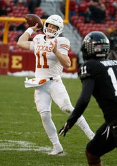 Quarterback Sam Ehlinger #11 of the Texas Longhorns throws the ball under pressure from defensive back Lawrence White #11 of the Iowa State Cyclones in the first half of play at Jack Trice Stadium on November 16, 2019 in Ames, Iowa.