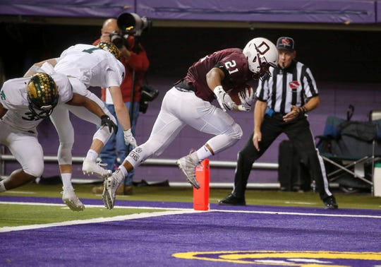 Dowling Catholic senior running back Gavin Williams scores a touchdown in the second quarter against Cedar Rapids Kennedy at the UNI-Dome in Cedar Falls on Friday, Nov. 15, 2019.