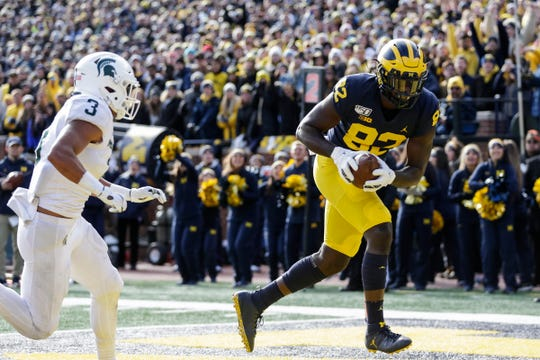 Michigan tight end Nick Eubanks scores a touchdown against Michigan State during the first half at Michigan Stadium in Ann Arbor on Saturday, Nov. 16, 2019.
