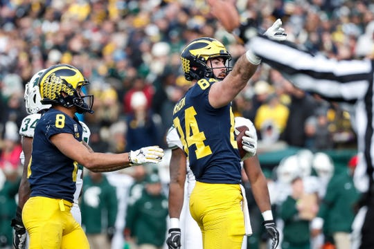 Michigan tight end Sean McKeon celebrates a first down against Michigan State during the second half at Michigan Stadium in Ann Arbor, Saturday, Nov. 16, 2019.