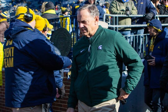 Michigan State coach Mark Dantonio walks out of the tunnel before the game at Michigan Stadium on Saturday, November 16, 2019.