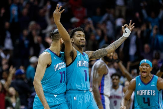 Charlotte Hornets guard Malik Monk, center, celebrates after hitting the winning 3-pointer as time expired to beat the Detroit Pistons, 109-106, in Charlotte, N.C., Friday, Nov. 15, 2019.