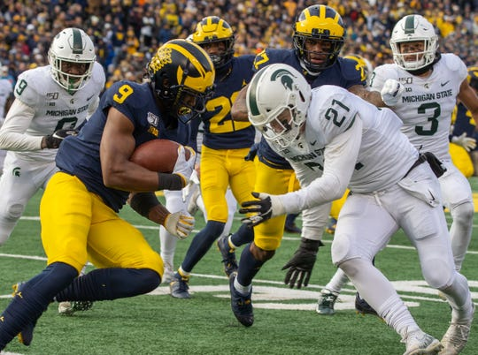 Michigan receiver Donovan Peoples-Jones carries the ball before being tackled by Michigan State linebacker Chase Kline at Michigan Stadium in Ann Arbor, Saturday, Nov. 16, 2019. Michigan won, 44-10.