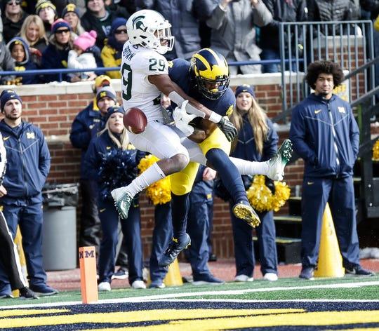 Michigan State cornerback Shakur Brown defends Michigan receiver Nico Collins during the first half at Michigan Stadium on Saturday, Nov. 16, 2019.