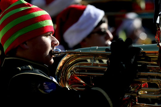One of several marching bands that brought a festive atmosphere performing Christmas songs during the annual Wyandotte Christmas parade going down Biddle Avenue in downtown Wyandotte, Michigan on November 16, 2019.Over 3,000 people crowded both sides of the sidewalk on Biddle Avenue to watch the parade on a sunny but cool morning.