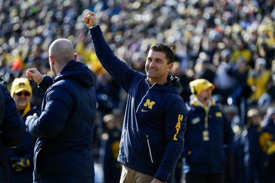 Michigan baseball coach Erik Bakich waves at the crowd during the football game against Michigan State at Michigan Stadium in Ann Arbor, Saturday, Nov. 16, 2019.