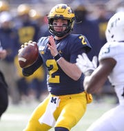 Shea Patterson passes against Michigan State during the first half.