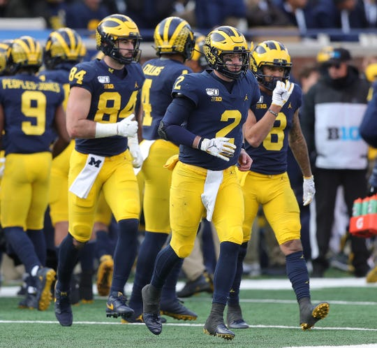 Michigan Wolverines quarterback Shea Patterson (2) leads the offense onto the field during the second half against Michigan State, Saturday, Nov. 16, 2019 at Michigan Stadium in Ann Arbor.