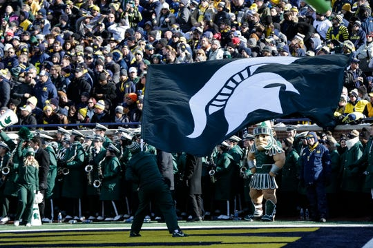 Michigan State flies a flag to celebrate a touchdown against Michigan during the first half at Michigan Stadium in Ann Arbor, Saturday, Nov. 16, 2019.
