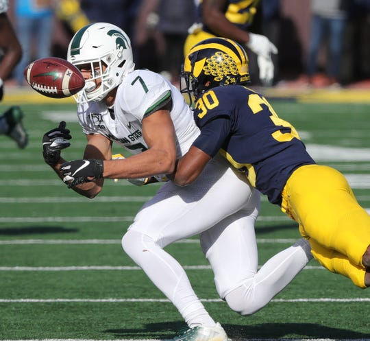 Michigan defensive back Daxton Hill breaks up a pass to Michigan State receiver Cody White during the first half Saturday, Nov. 16, 2019 at Michigan Stadium.