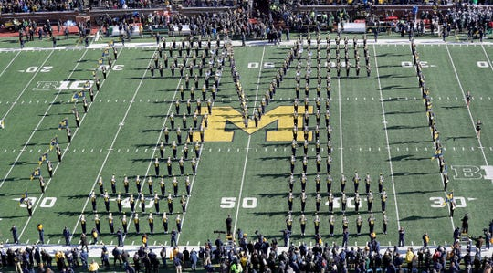 The Michigan marching band takes the field before the game against Michigan State on Saturday, Nov. 16, 2019, at Michigan Stadium.