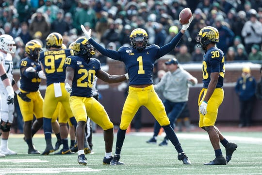 Michigan defensive back Ambry Thomas (1) celebrates his interception against Michigan State during the second half at Michigan Stadium in Ann Arbor, Saturday, Nov. 16, 2019.