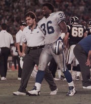 Detroit Lions safety Bennie Blades is helped off the field after an injury by assistant athletic trainer Joe Recknagel during a game in San Diego, California, Nov. 11, 1996.