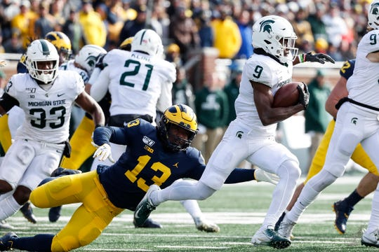 Michigan State's Anthony Williams Jr. returns a kick in the first half Saturday.