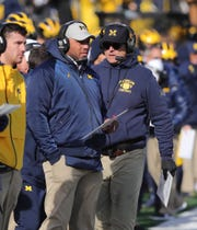 Michigan offensive coordinator Josh Gattis and coach Jim Harbaugh on the sideline Saturday, Nov. 16, 2019, at Michigan Stadium vs. Michigan State.