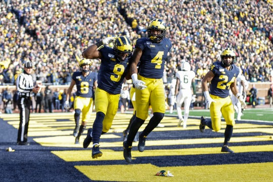 Michigan receiver Nico Collins (4) celebrates his touchdown with teammate Donovan Peoples-Jones (9) during the second half at Michigan Stadium in Ann Arbor, Saturday, Nov. 16, 2019.